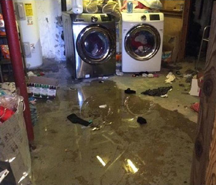 Storm Waters Damage Bangor-Area Home's Basement Before